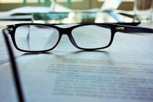 astute-immigration-lawyers-visas-glasses
